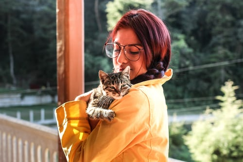 Emotional Support Animal Snuggling with Woman